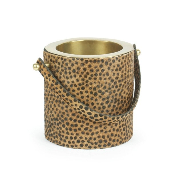 This cheetah print wine cooler would be a great accent at your next dinner party. Check out the other leopard and cheetah home accessories I rounded up in my latest blog post. Link in bio. #leopard #cheetah #animalprint