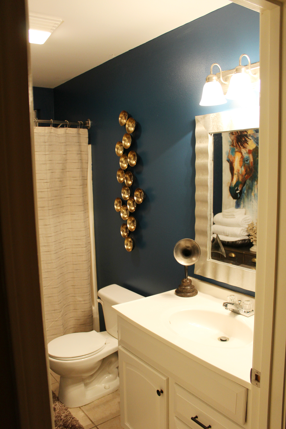 Before and after reveal blue eclectic guest bathroom whitney j decor for How to decorate a guest bathroom