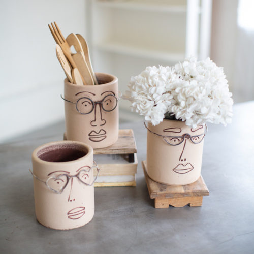 clay face planters with glasses